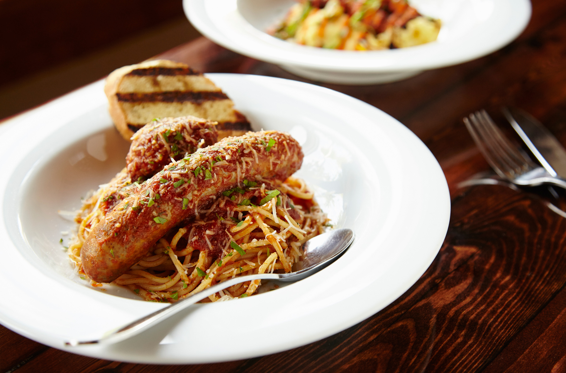 Italian Sausage and Meatball with Spaghetti photo by Chris Kessler Photography.  Chris Kessler is a freelance Photographer based in Milwaukee Wisconsin. Specializing in Food photography and portraiture.