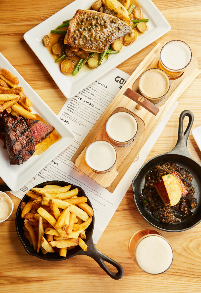 Sirloin Strip Steak,BARRAMUNDI, Pork Belly, Craft beer, french fries. photo by Chris Kessler Photography. Sliced meat. Chris Kessler is a freelance Photographer based in Milwaukee Wisconsin. Specializing in Food photography and portraiture.
