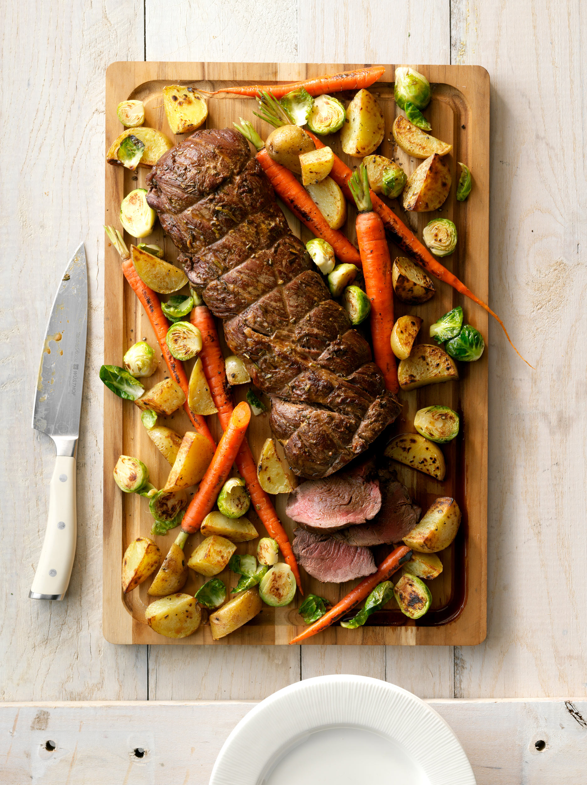Beef Tenderloin with Roasted Vegetables photo by Chris Kessler Photography.  Chris Kessler is a freelance Photographer based in Milwaukee Wisconsin. Specializing in Food photography and portraiture.